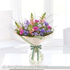 Spoil someone special today with this Antirrhinum and Iris Hand- tied bouquet. Showcasing some beautiful blooms of to give a feel of Spring. It includes pink antirrhinums, purple freesia, cerise carnations, blue iris with complimenting foliage. Sandra's Florist will skilfully create this this breath-taking bouquet using the finest quality flowers  and beautifully gift-wrap for the perfect gift.