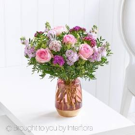 Pretty pastel shades of seasonal flowers beautifully presented in a rose glass vase. Our Fragrant Perfect Gift arrangement is a popular choice as a special flower gift for any occasion. To create this floral arrangement, our skilled team at Sandra's Florists use a selection of the finest blooms including pink roses, pink stocks and mixed sweet Williams. Green Alchemilla mollis and complimenting foliage is also added to beautifully enhance the natural colours of the flowers.
