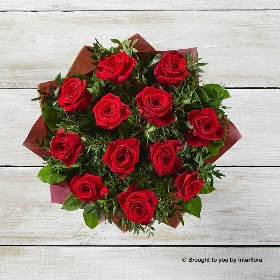 Something for all the senses with our bestselling Dramatic Dozen bouquet, features quality large headed red roses with complimenting foliage and a box of Dairy Milk Chocolates. The hand-tied bouquet will be skilfully created by one of the Sandra's Florist team and gift wrapped and presented in beautifully for the ultimate valentines bouquet.
