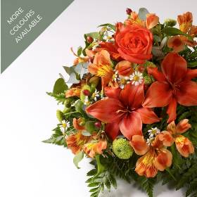 A classic funeral posy arrangement created from fresh flowers selected by one of the skilful team at Sandra's Florist. The tribute is available in three colour tones: orange and green, pink and white or Blue, yellow orange and green.