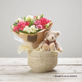 This Baby Girl Pink Bundle is the perfect gift to celebrate the birth of a new born baby. This delicate design features the finest pink Alstromeria, scented white freesia and pink lisianthus, complemented by glossy dark green foliage. These flowers are expertly arranged into a petite Hand tied bunch, perfect for Mum to enjoy. Gigi Giraffe, a beautiful plush soft toy meeting all safety standards will surely become baby's favourite. These are paired together and presented in a useful soft woven jute basket. This will be carefully hand delivered by Sandra's Florist and will delight the new parents.