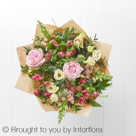 This delightful gift box features pink large headed roses, cerise alstroemeria, pink antirrhinum and cream lisianthus with complimenting foliage. This hand-tied will be skilfully created by one of Sandra's Florist's experts and gift wrapped and presented in a pink Summer Garden gift box.