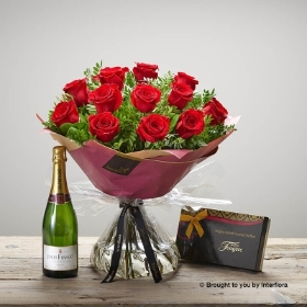With the stunning skilfully arranged hand-tied bouquet featuring 12 red large headed roses with complimenting foliage that's presented in quality gift packaging, a box of delicious Maison Fougere Salted Caramel Truffles and a bottle of Jules Feraud Champagne this design is pure luxury; you know they're worth it!