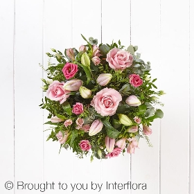 This is a stunning soft pink handtied bouquet. Skillfully created by Sandra's Florist it features pink large headed roses, pink alstroemeria, pink oriental lilies, pink lisianthus and complimenting foliage. It's finished and presented with beautifully gift packaging.