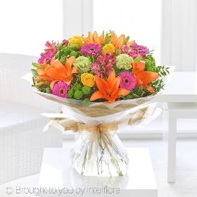 This bright and colourful bouquet includes alstroemeria, carnations, cerise germinis,  Asiatic lilies, large headed roses and green spray chrysanthemums with complimenting foliage. It's skilfully created by Sandra's Florist and beautifully gift-wrapped and presented in Gift Packaging.